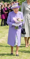 Image may contain: Elizabeth II, Human, Person, Hat, Clothing, Apparel, Plant, Flower, Flower Bouquet, and Flower Arrangement