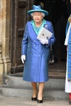 Image may contain: Elizabeth II, Clothing, Apparel, Coat, Hat, Overcoat, Sleeve, Human, Person, Footwear, and Shoe